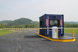 Turnstiles, MSSI, perimeter security solution, vehicle access control, vehicle access control portal, vehicle barrier arms in a guard house, vehicle barrier gate, vehicle barrier arms, vehicle access control with a guard office