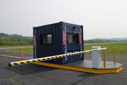 vehicle barrier gate, vehicle barrier arms in a guard house, vehicle access control, vehicle access control portal, portable guard house with vehicle barrier arms, modular security systems inc, MSSI, modular vehicle access control portal, Modular Security Systems Inc