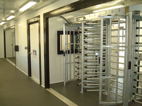 MSSI,V-Series MAC Portal,perimeter security solution,turnstiles,perimeter security,turnstiles and access control,Turnstiles in a container,guard office with turnstiles,perimeter turnstiles